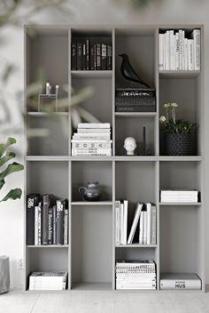 IKEA bookcase hack using 2 VALJE shelf units flipped 90° and grey painted
