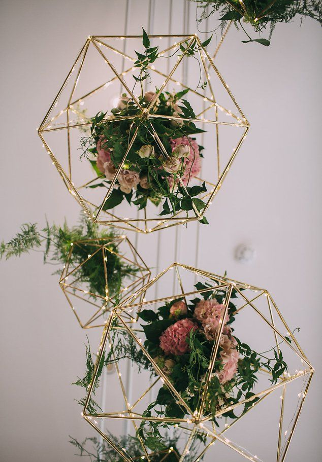 We've had geometric shapes before but we love the addition of the flowers! Just one more beautiful dynamic for hanging decorations