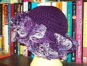 Grape Swirl Hat - ruffle yarns can make more than the twirly scarves! Free pattern!