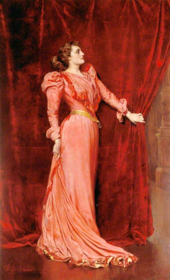 Julia Neilson-Terry (1868–1957), as Drusilla Ives in 'The Dancing Girl' (1891).John Collier (English, 1850-1934). Oil on canvas.Royal Academy of Music. Neilson-Terry (1868–1957), depicted full-length as Drusilla Ives, is shown in a private moment peering out from behind the grand red velvet theatre curtain before going onstage. She wears a long pink dress and her head is held high. The portrait was given by Collier to the Terrys as a wedding present.