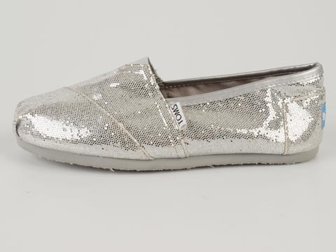 A pair of glitter Toms