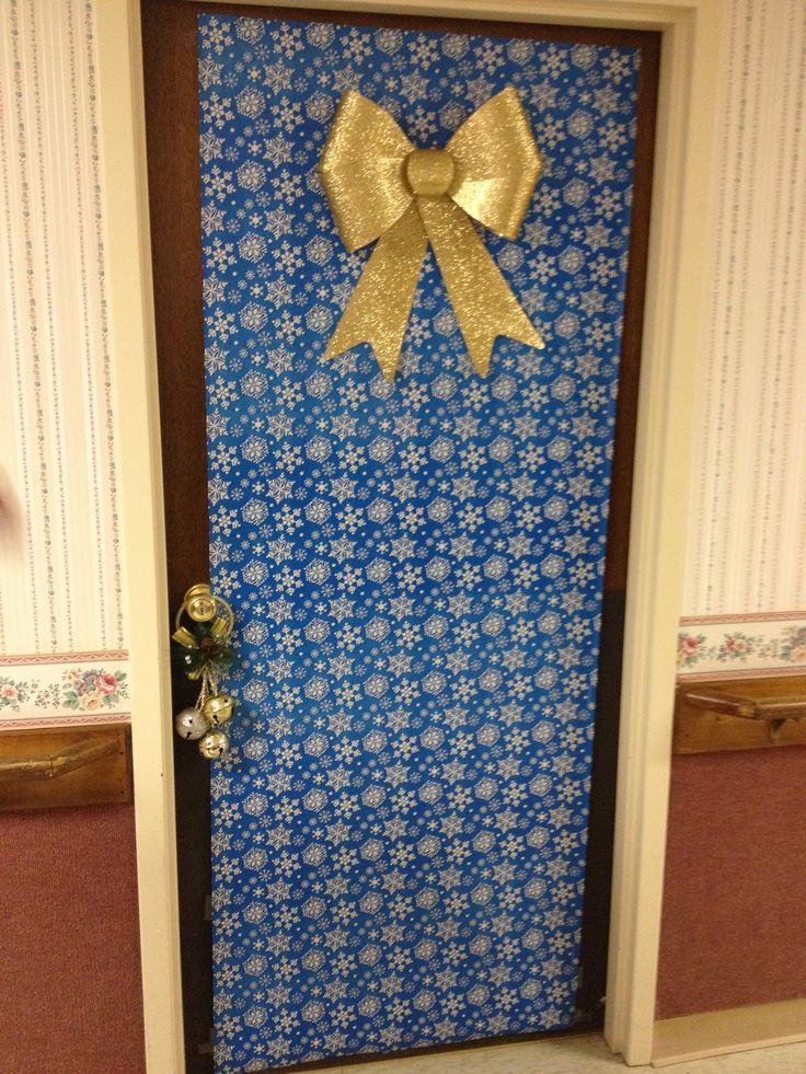 Service In A Nursing Home Decorate Doors During Christmas