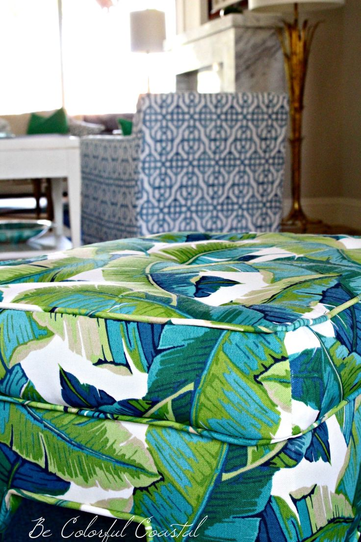 blue and green banana print upholstered bench paired with blue trellis chairs.@becolorfulcoastal  http://bit.ly?2GWltEQ