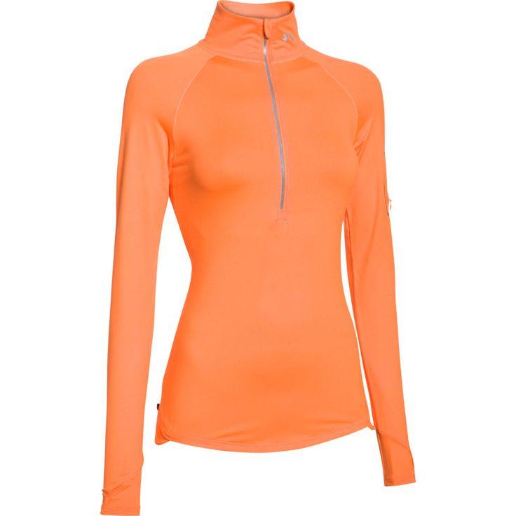 Naisten tekninen juoksupaita poolokauluksella. Vetoketjutaskut hihassa ja alaselässä. Muotoiltu helma.