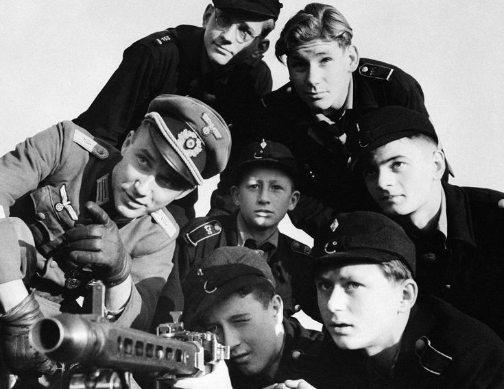 best hitler youth images wwii and youth a group of hitler youth receive instructions in the use of a machine gun