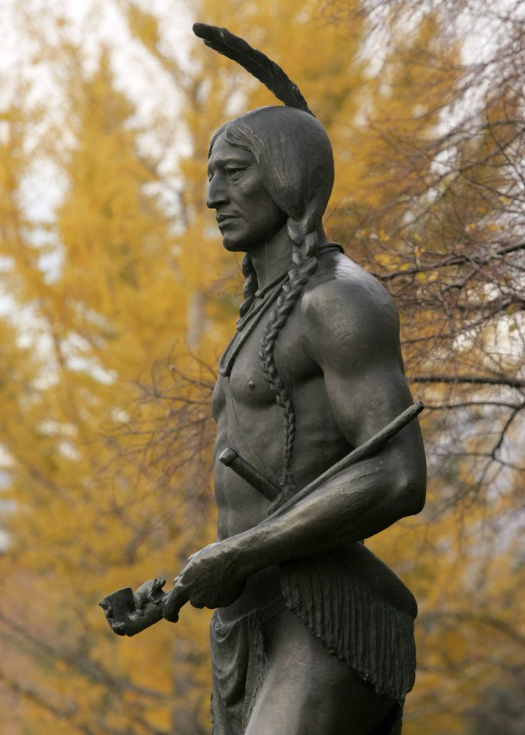 """The bronze sculpture of Chief Massasoit, or """"Yellow Feather,"""" stands near the southwest edge of the Harold B. Lee Library."""