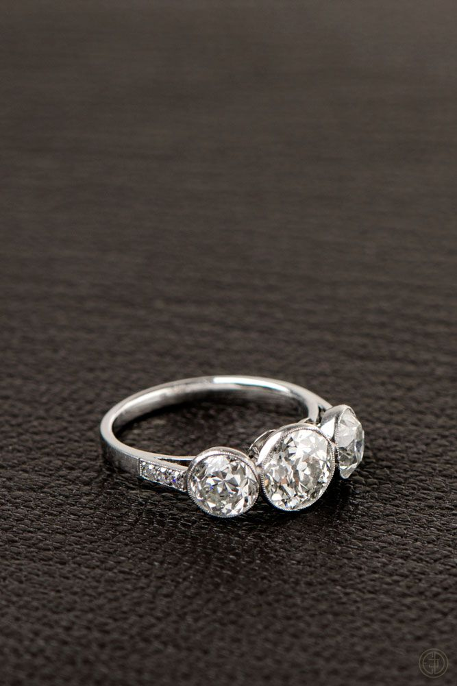 Three Stone Bezel Diamond Ring