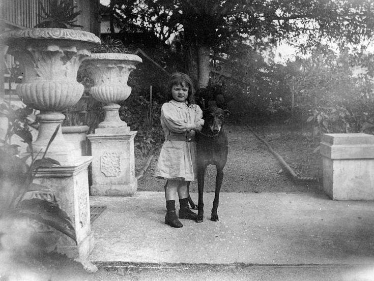 Margaret Granville Wandooline Stuart posing with her dog at her home in Emma Street, Toowong, Brisbane, 1899.