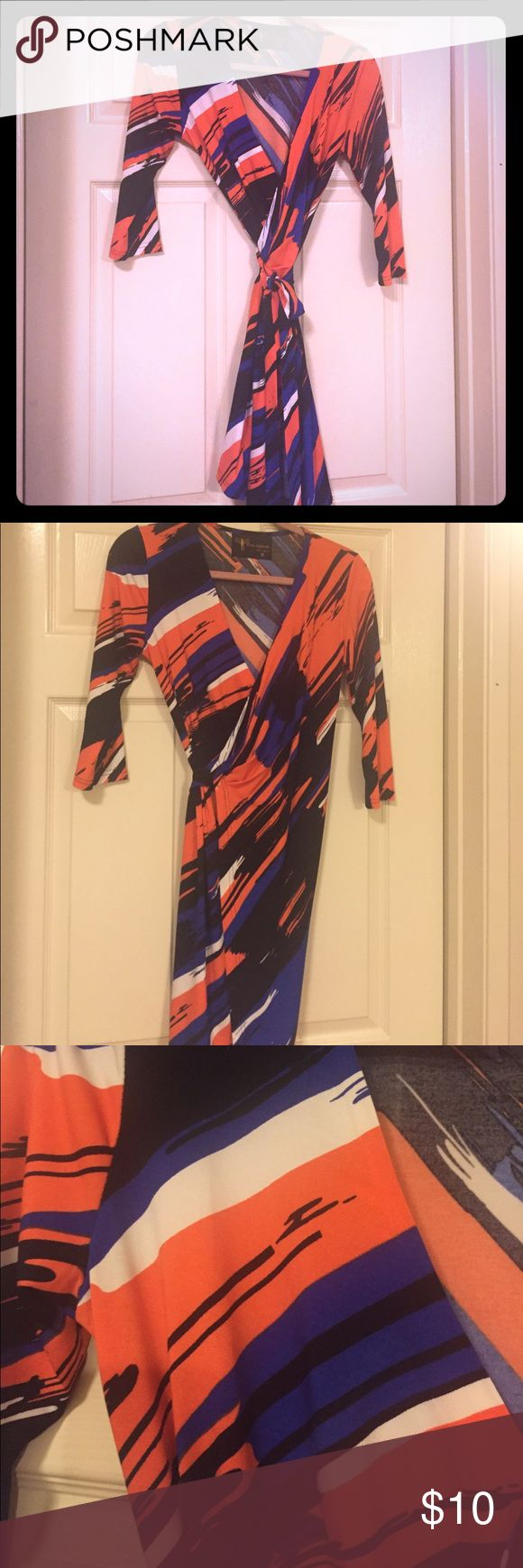 Denver Broncos colors - wrap dress Wrap dress.  Size Medium.  Denver Broncos colors which I took advantage of during the season. Great condition Dresses