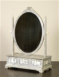 A fine late George III period Anglo-Indian Vizagapatam ivory and sandalwood dressing mirror, circa 1790.