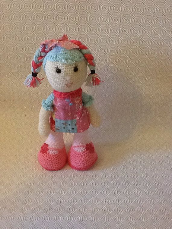 Sylia is her name and she is 35cm tall.She wears a dress made from cotton fabric and she has two wonderful two-colored brades.