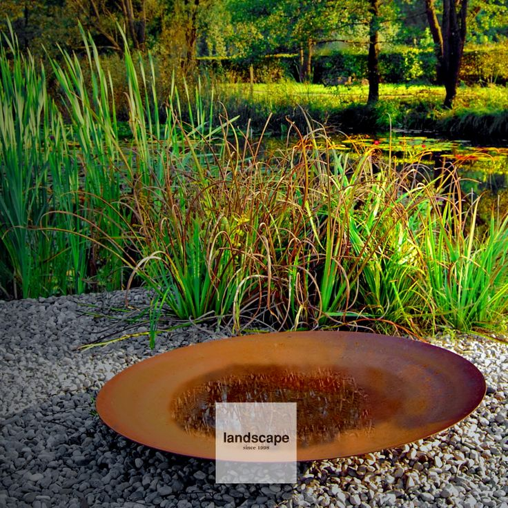 #Rural #garden near #Ljubljana, #Slovenia. #Extremis #Qrater #fire plate was placed on #pebble #beach by the natural #pond. For #summer #picnics with marshmallows. / design: Landscape d.o.o. / www.landscape.si / fb landscap slovenia /