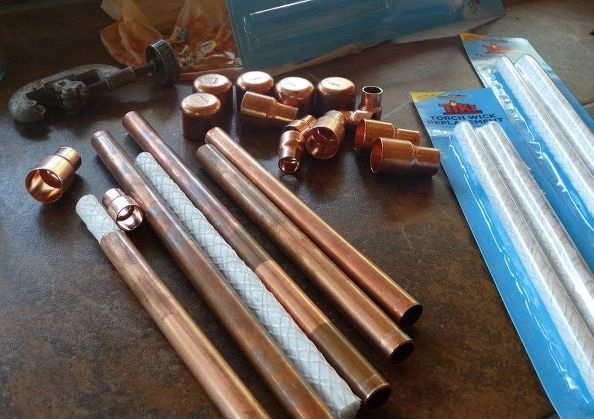How to turn empty glass bottles into easy tiki torches for Diy beer bottle tiki torches