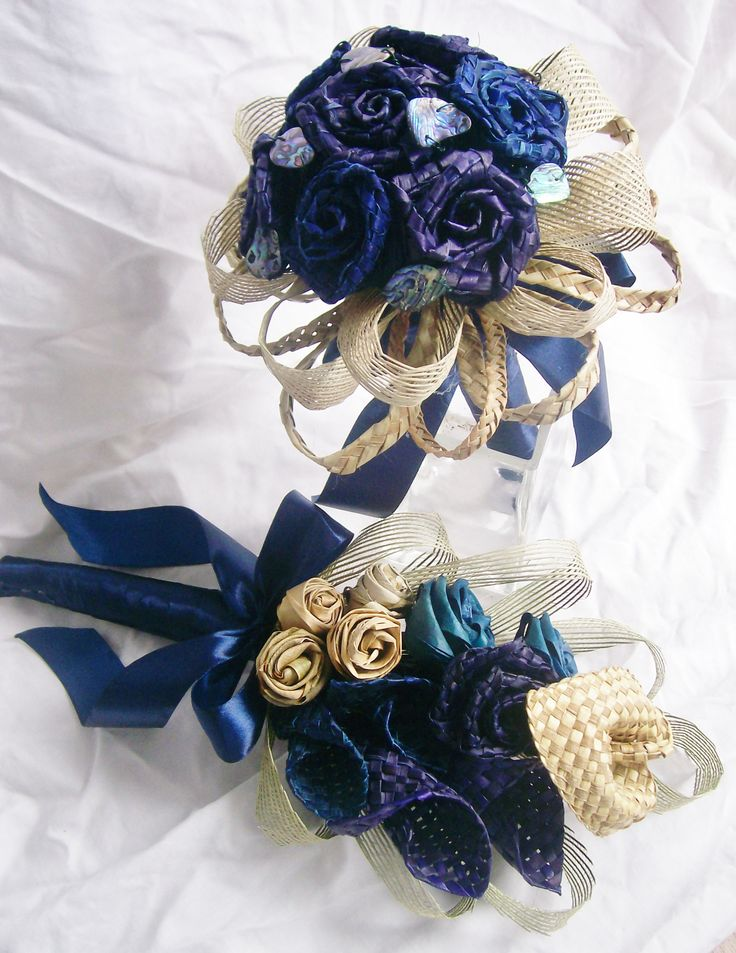 Blue and purple flax wedding set accented with natural flax and paua shell details