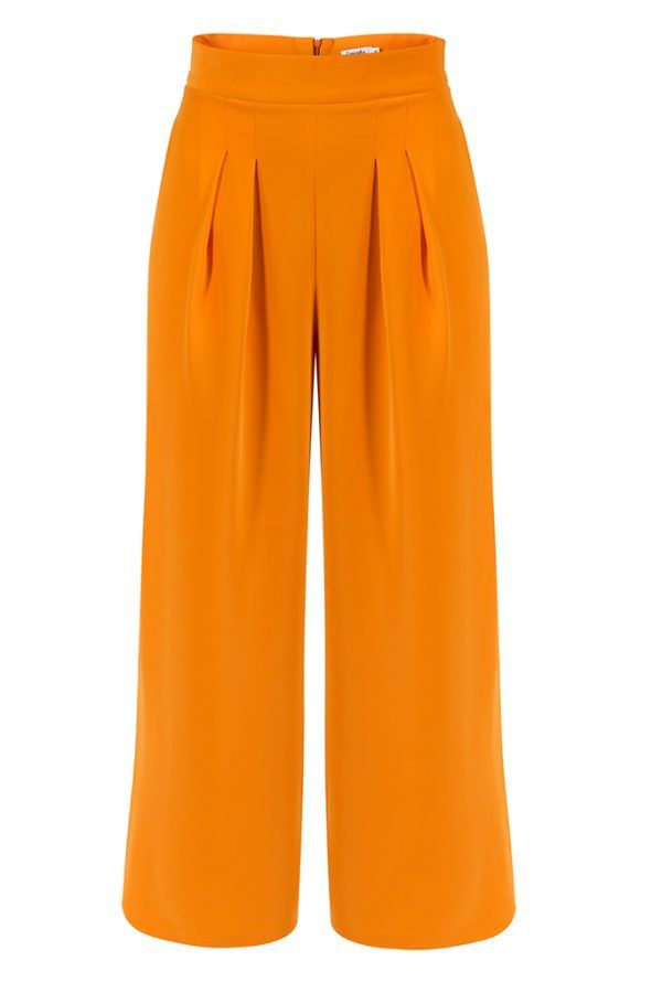 CHARLOTTE PANTS  This orange pair of trousers will slip seamlessly into your upper-class wardrobe.  Skillfully created by Concepto, they sit high on the waist, while the wide, A-line legs are elegantly pleated.  The minimalist tailoring is an exquisite example of the brand's bold aesthetic so get prepared to enjoy a spectacular look