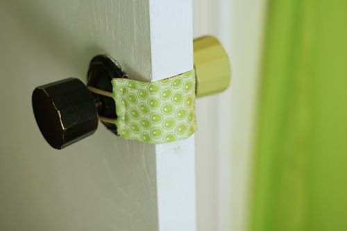 diy door latch cover so the door doesn't make noise in the baby's nursery when you close it.