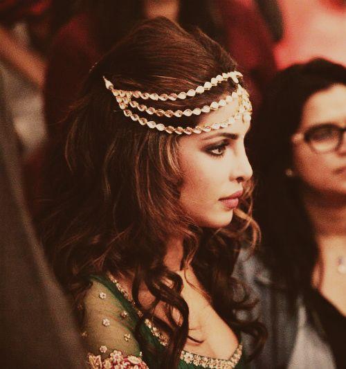 Priyanka Chopra showing a great way to wear a matha patti with open curls
