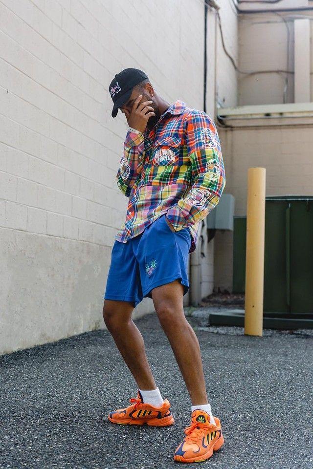 Luce wearing Adidas Yung-1 Sneakers In Orange, Billionaire Boys Club Multi  Check Shirt 5c7b1337974