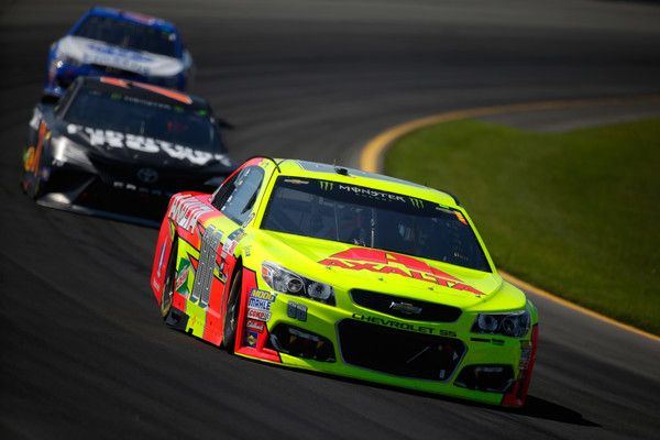 Dale Earnhardt Jr. Photos Photos - Dale Earnhardt Jr., driver of the #88 Axalta Chevrolet, leads a pack of cars during the Monster Energy NASCAR Cup Series Axalta presents the Pocono 400 at Pocono Raceway on June 11, 2017 in Long Pond, Pennsylvania. - Monster Energy NASCAR Cup Series Axalta Presents the Pocono 400