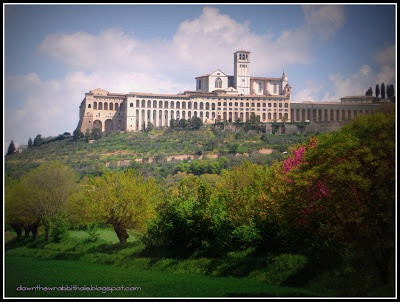 """The Basilica of St. Francis in Assisi from afar. Find out more at """"Down the Wrabbit Hole - The Travel Bucket List"""". Click the image for the blog post."""