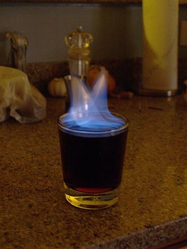 Flaming Jesus - 2/3 Shot of vodka 1 splash of lime juice 1 splash of grenadine syrup Rum