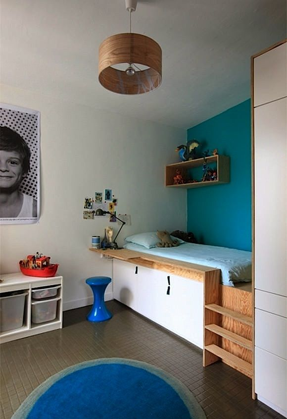 boys room loft bed with cabinet storage below