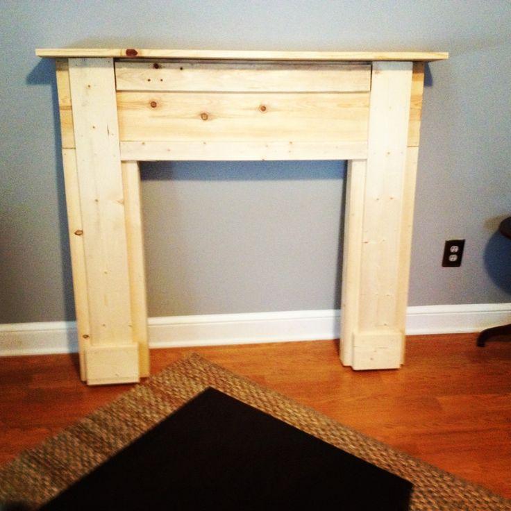 Building a faux fireplace mantel. Still needs paint.   diy ...