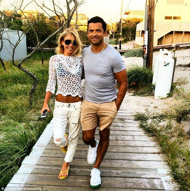 Taut tummy: Kelly Ripa, 43, showed off her enviably svelte figure along with her 43-year-old husband Mark Consuelos in a snap shared on Instagram Tuesday