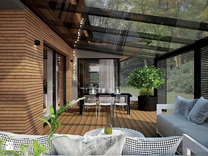 dom jednorodzinny - Duży taras z tyłu domu, styl nowoczesny - zdjęcie od TK Architekci