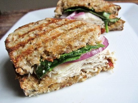 Turkey Caprese Panini : There is so much goodness on this turkey caprese panini: turkey, sun-dried tomato, goat cheese spread, red onion, and spinach!