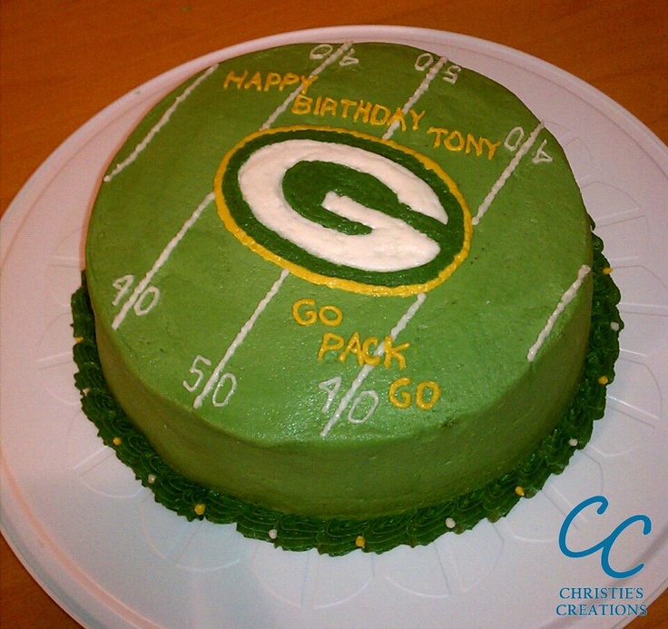 "Green Bay Packers Cake - 9"" Round Cake with Two Layers of Chocolate Fudge Cake with Peanut Butter Chunks. Separated by Peanut Butter Cream Cheese Filling. Covered in Peanut Butter Buttercream Frosting (Facebook.com/ChristiesBakingCreations)"