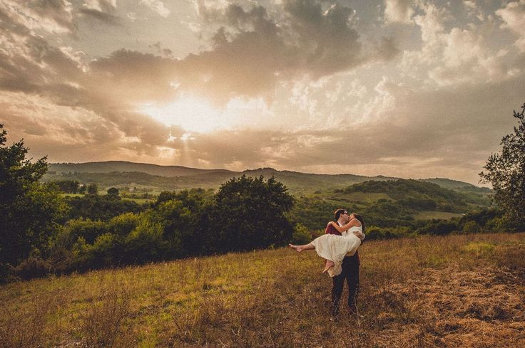 Taking a beautiful picture includes a kiss in the sunset too