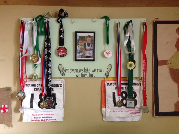 An old Sleeping Beauty canvas me and my mum painted, added hooks, decided on the quote (from mine  my brothers running/triathlon club)  added the frame to make our own medal hanger