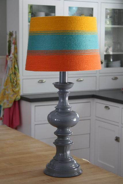 Colorful yarn-wrapped lamp shade.