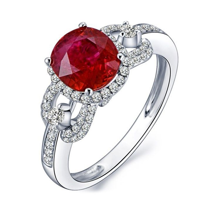 Colour stone halo ring in a diamond band.    www.uwekoetter.com