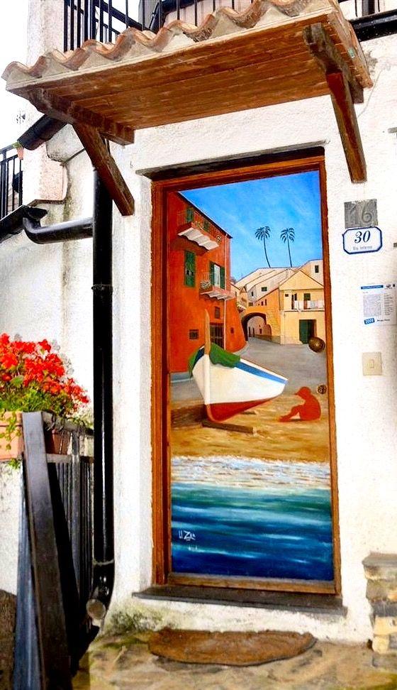 Seaside painted door in Valloria, Liguria, Italy.