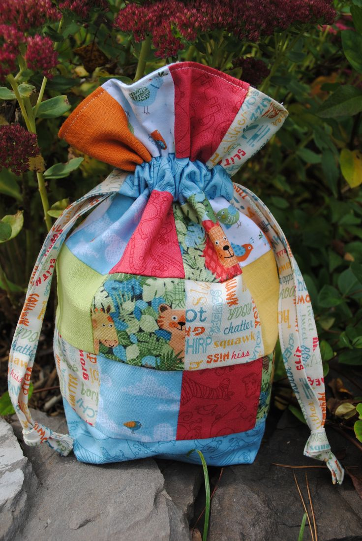 """Drawstring bag made with 2 1/2"""" squares #andoverfabric #junglefabric https://www.etsy.com/listing/162936767/pdf-patchwork-drawstring-bag-pattern?ref=shop_home_active"""