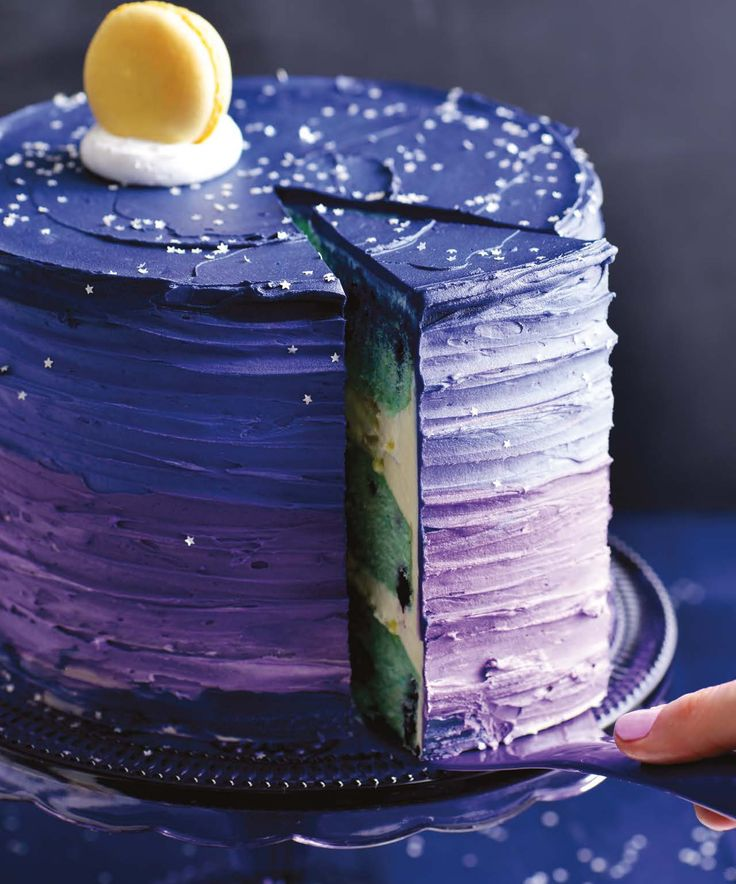 Sweetapolita has captured the dreamy essence of the rare blue moon with layered flavors of blueberry, vanilla, and citrus. | Get the recipe for Blue Moon Dream Cake
