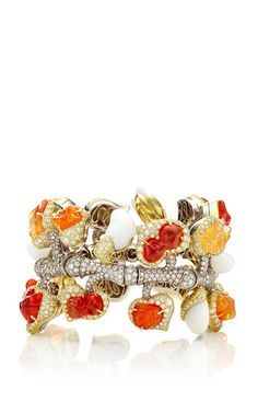 Rendered in both 18K yellow and white gold, this bracelet by **Nicholas Varney** features a playful representation of vines through multi-sized fire opals, pearls and orange sapphires and delicate diamonds through the piece.