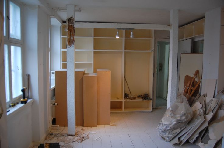 Week 1 - The kitchen-dining area after the wall was demolised, with white bearing beams
