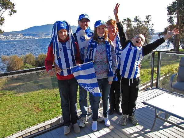 Keen AFL supporters travel to Hobart in Tasmania to watch the North Melbourne Kangaroos play at Blundstone Arena.