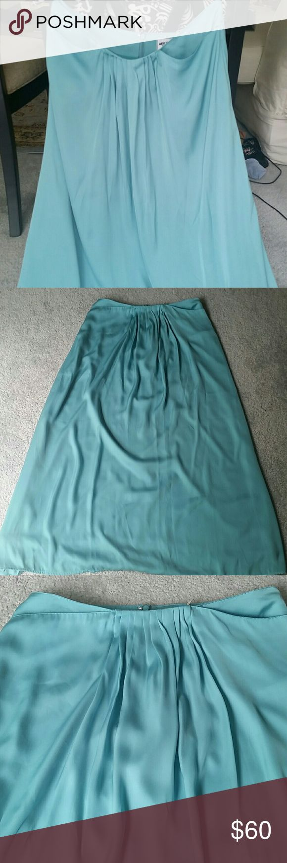 """NWT gorgeous minty turquoise maxi skirt Fully lined 100% polyester. Color may vary slightly from pictures due to computer screen variations. Tag describes it as """"mint"""". Never worn, NWT. Cute pleating at front waistline with 2 pockets. Love having pockets on my maxi skirts!!! American Retro Skirts Maxi"""