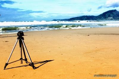 Tripod and beach