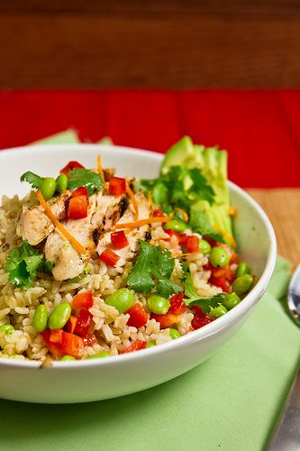 Chicken & Edamame with Orange-Ginger Dressing. Chicken and edamame in a light orange-ginger dressing, served over brown rice.