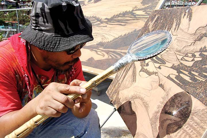 Artist Creates Paintings With The Power Of Sunlight Through A - Artist creates art power sunlight magnifying glass