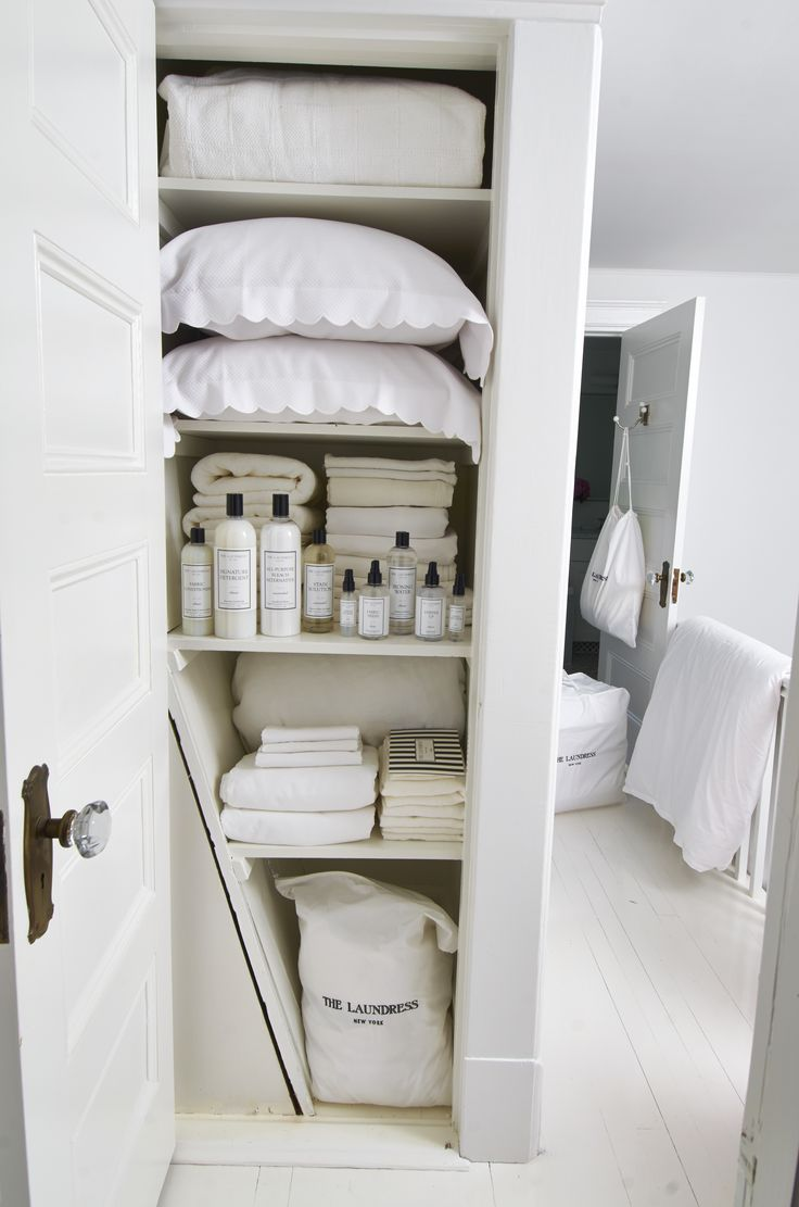 A Laundress-approved, organized white linen closet.