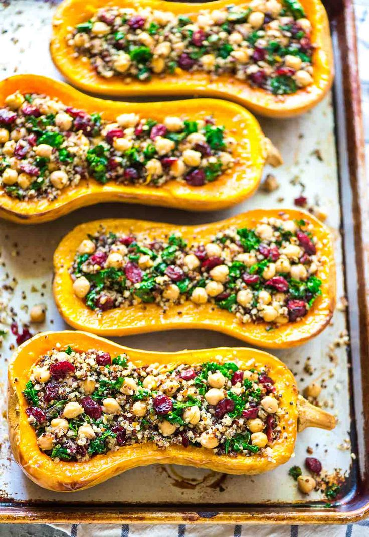 Delicious, healthy Stuffed Butternut Squash with Quinoa, Cranberries, Kale, and Chickpeas. An easy, satisfying vegetarian recipe that's perfect for fall!