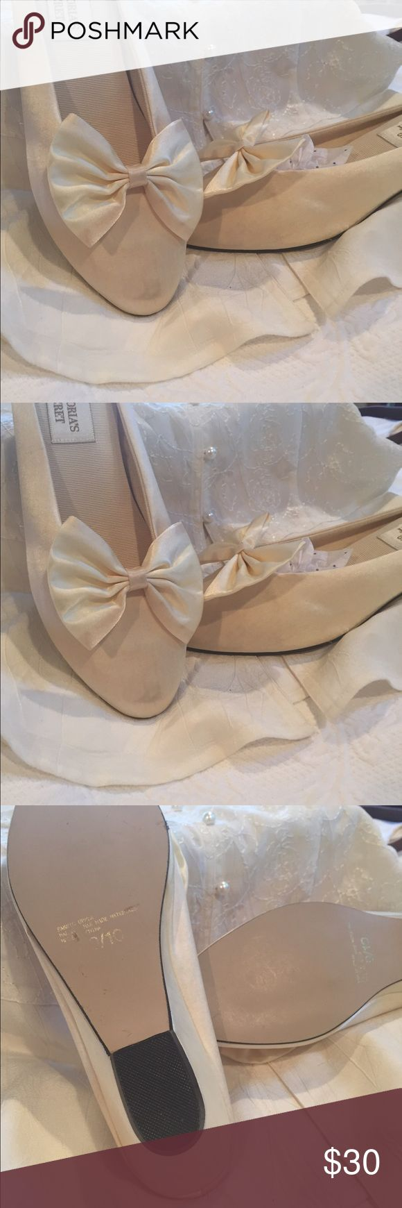 Vintage Victoria Secret satin slippers 9/10 Cream satin slippers with bow detail, slight wedge. Some smudges due to age but remarkably well kept, soles are clean. Very feminine and old Hollywood! Victoria's Secret Shoes Slippers