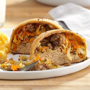 Hearty Beef & Cabbage Pockets Recipe -I found this recipe many years ago and the only ingredients listed were hamburger, cabbage, onion, salt and pepper. After a bit of experimenting, I decided this is one for the books. Homemade dough can be used or, If you can't find the frozen rolls, a 48-ounce package of frozen whole wheat bread dough can be cut into 24 pieces instead. —Elaine Clark, Wellington, Kansas