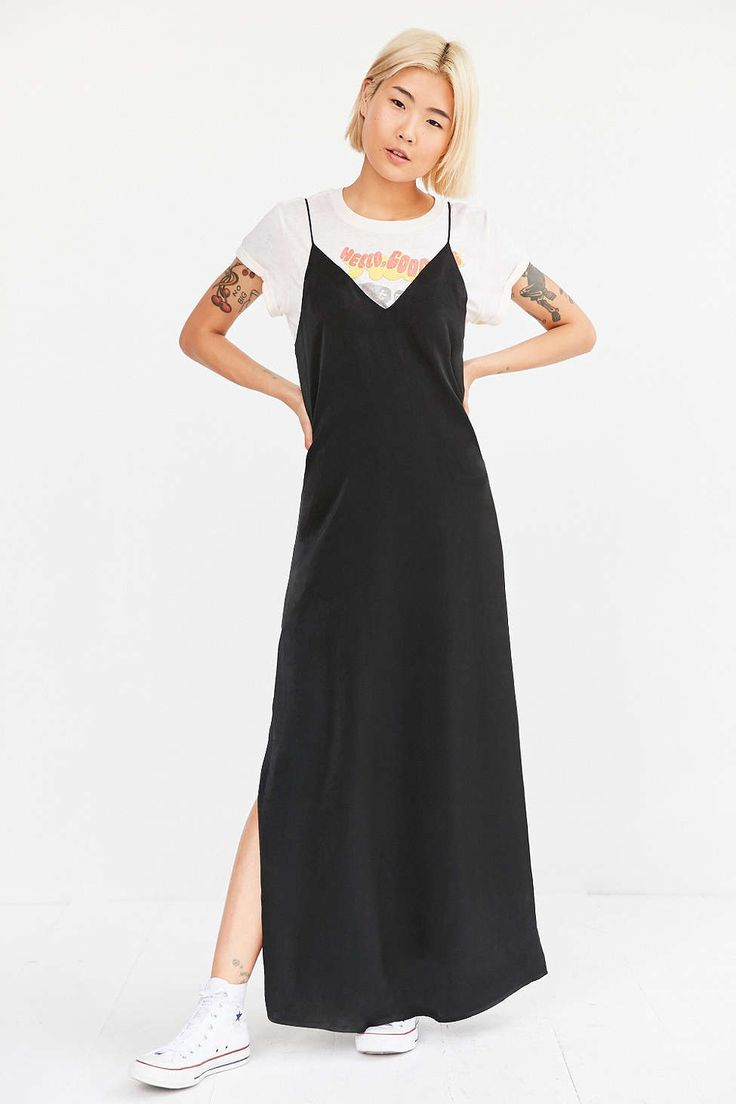 Black slip dress with graphic tee and white converse | UrbanOutfitters.com